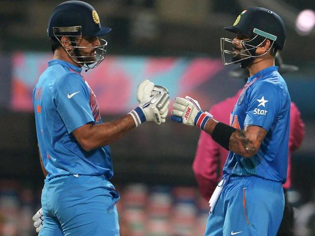 India's captain Mahendra Singh Dhoni and teammate Virat Kohli speak during the World T20 cricket tournament