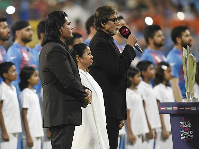 Amitabh Bachchan and chief minister of West Bengal Mamata Banerjee look on as Shafqat Amanat Ali sings the Pakistan national anthem at The Eden Gardens in Kolkata.