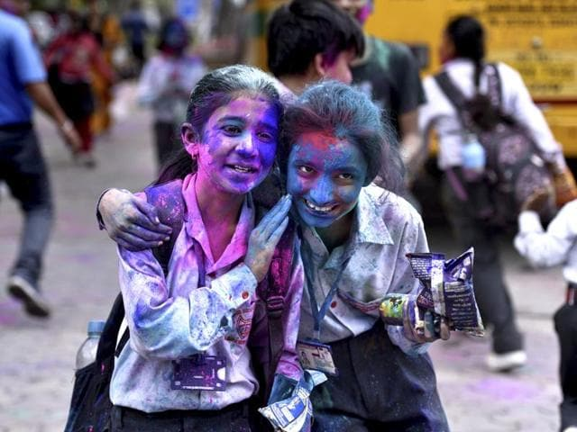 Students in Delhi celebrating Holi after school hours.