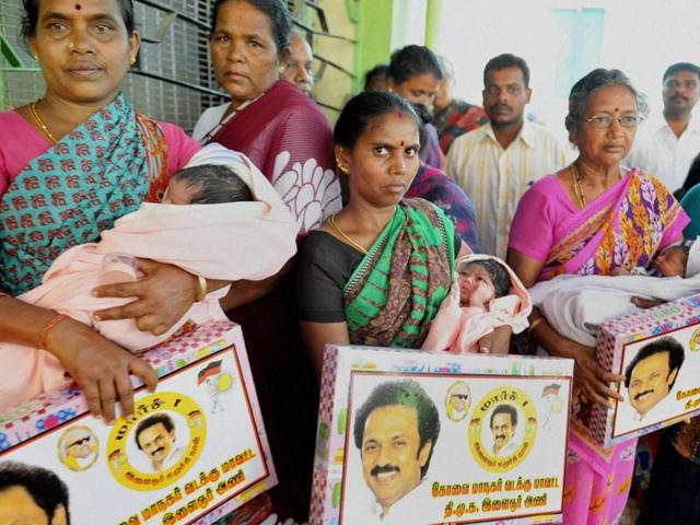 DMK members gift gold chains and baby-sets to the newly born babies in a hospital