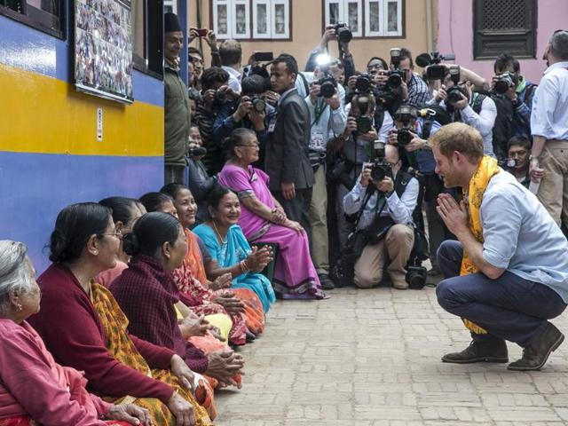 Britain's Prince Harry visits Nepalese families displaced by the 2015 earthquakes at a camp in Bhaktapur on March 20. The prince is on a five-day visit to Nepal to meet quake survivors and Gurkha soldiers.