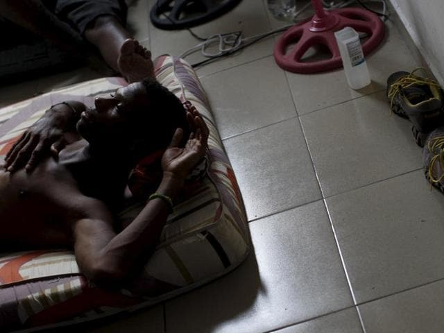 A Cuban migrant rests inside a room at an old hotel used as a provisional shelter in Paso Canoas, at the border with Costa Rica.