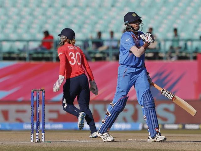 India's Smriti Mandhana walks back after her dismissal.