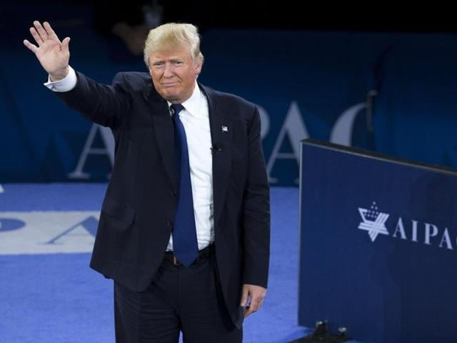 US Republican Presidential hopeful Donald Trump waves after addressing the American Israel Public Affairs Committee.