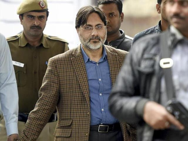 Delhi Police officials with SAR Geelani, the former Delhi University lecturer who was booked for sedition for allegedly organising an event marking the death anniversary of Parliament attack convict Afzal Guru.