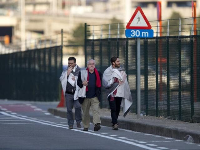 People leave Zaventem Airport, one of the sites of two deadly attacks in Brussels, Belgium.