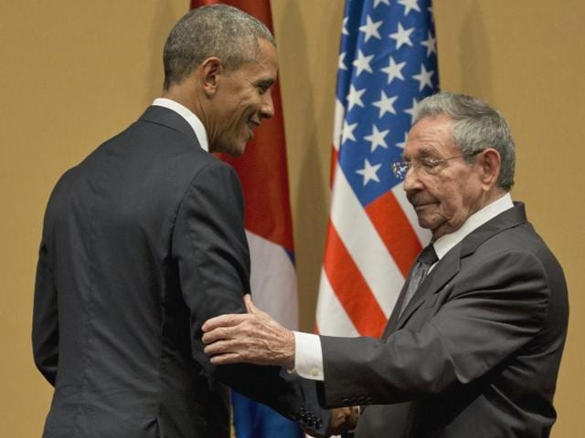 Cuban President Raul Castro checks his watch near the end of a joint news conference with President Barack Obama at the Palace of the Revolution, Monday, March 21, 2016 in Havana, Cuba.