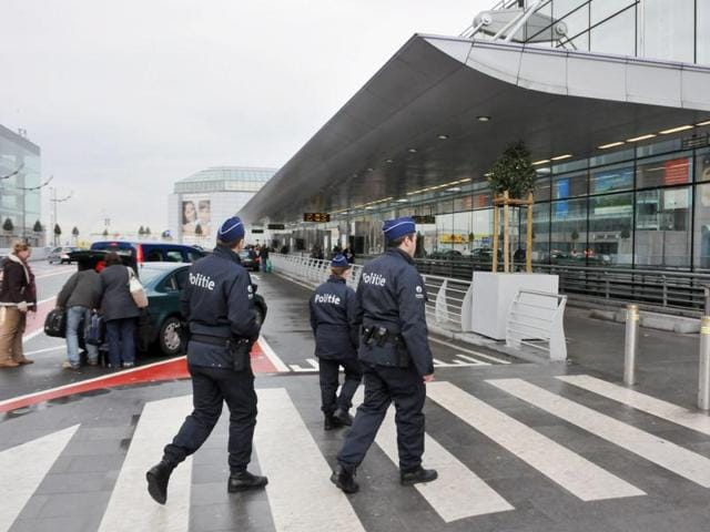 This file photo taken on August 03, 2015 shows people walking in the departures hall of Brussels Airport in Zaventem. Two explosions were heard at Brussels Airport on March 22, 2016 B