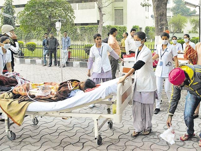 Patients outside the building of Mohandai Oswal Hospital which went up in flames, in Ludhiana on Monday.(JS Grewal/HT Photo)