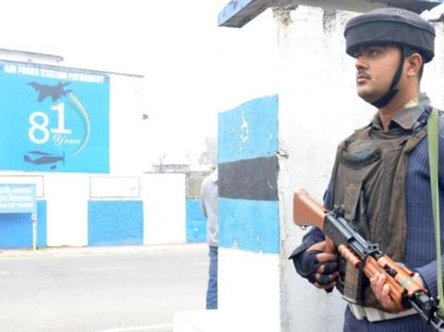 A soldier stands guard outside the Pathankot Air Force base.