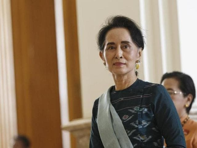 National League for Democracy (NLD) party leader Aung San Suu Kyi arrives at the Union Parliament in Naypyitaw, Myanmar.