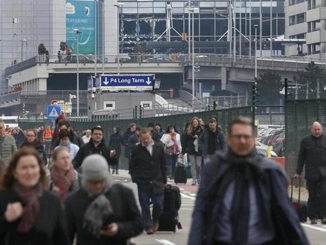 Injured people are seen at the scene of explosions at Zaventem airport near Brussels.