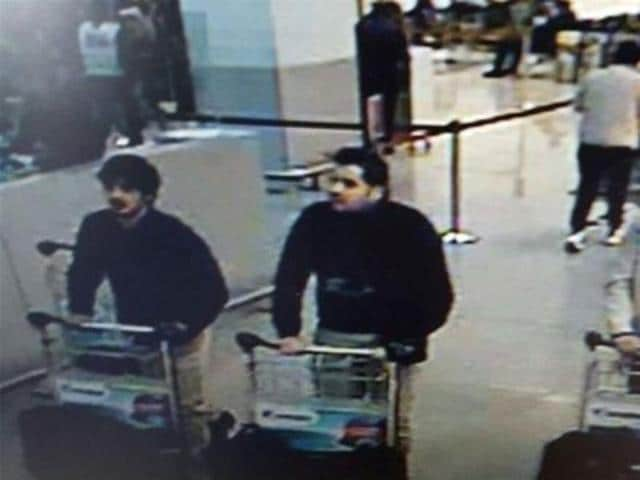 A picture released by the Belgian federal police shows a screengrab of the airport CCTV camera showing suspects of the attacks at Brussels Airport.