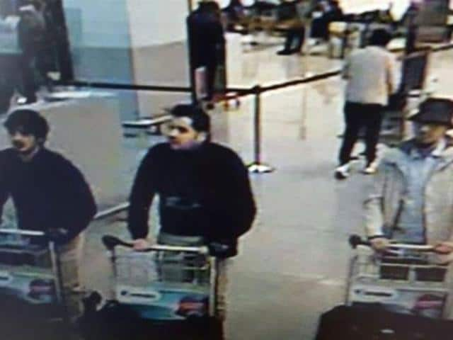 A picture released on March 22, 2016 by the belgian federal police shows a screengrab of the airport CCTV camera showing suspects of attacks at the Brussels Airport, in Zaventem.