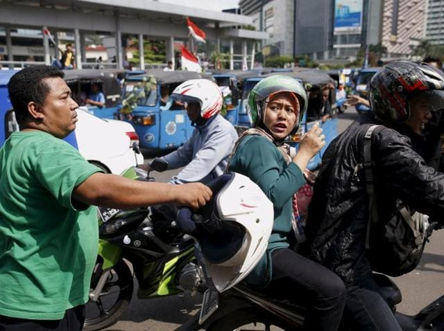 Jakarta protests,Cabbies protest in Jakarta,Ride-hailing apps