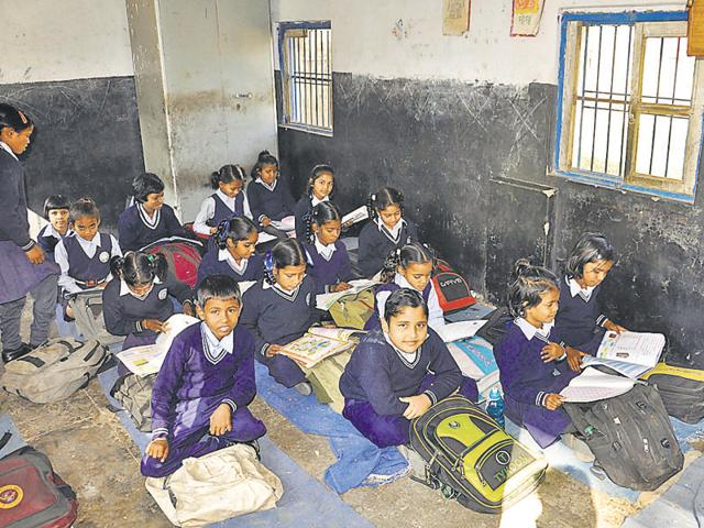 The walls of a classroom at the primary school in Railway Colony reflect lack of upkeep.