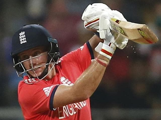 England's Joe Root celebartes his half century during a ICC WT20 match against South Africa.