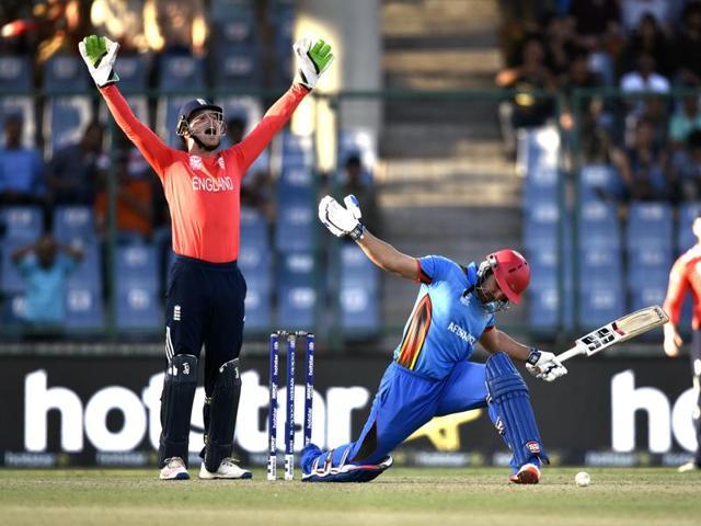 England wicketkeeper Jos Buttler apeals for Afghanistan batsman Samiullah Shinwari during their ICC Twenty20 World Cup match at Ferozshah Kotla ground in New Delhi.