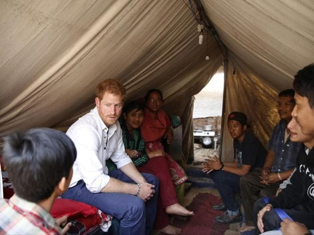 Britain's Prince Harry visits Nepalese families displaced by the 2015 earthquakes at a makeshift camp in Bhaktapur on March 20, 2016.