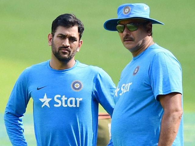 MS Dhoni with team director Ravi Shashtri during a training session at Chinnaswamy Stadium.