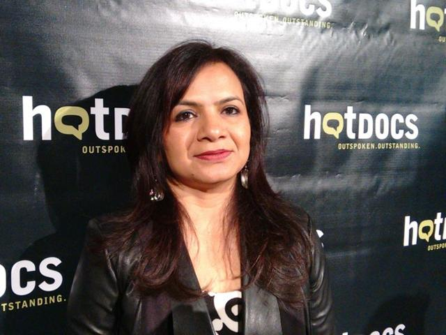 Indo-Canadian filmmaker Rama Rau poses for the camera at Hot Docs. Hot Docs is North America's largest documentary film festival.