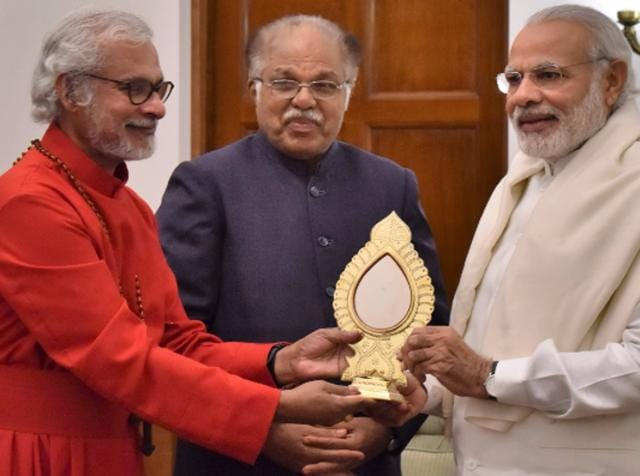 Yohannan Punnose (L) presents Prime Minister Narendra Modi an award during their meeting in New Delhi.