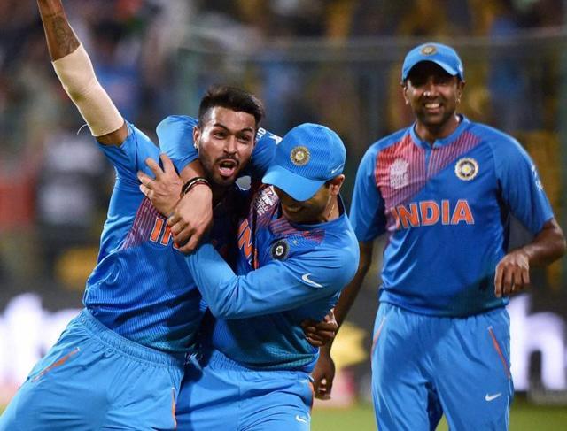 India's Hardik Pandya with team mates celebrate the win over Bangladesh during the ICC World T20 match between India and Bangladesh at Chinnaswamy Stadium in Bengaluru.