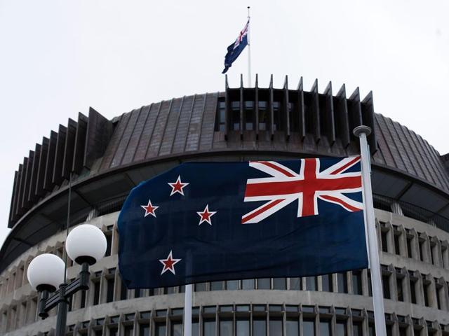The current New Zealand flag flies on Parliament buildings in Wellington's Central Cusiness District on Thursday.