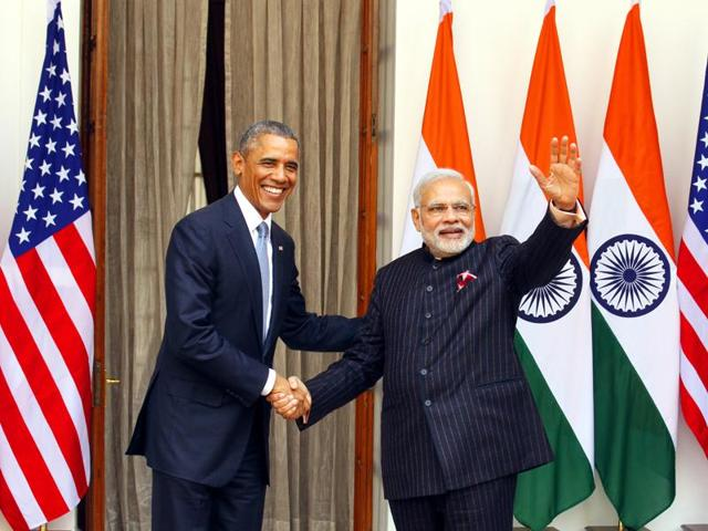 President Barack Obama shakes hands with Prime Minister Narendra Modi. A Bill has been introduced in Congress to help India join APEC.