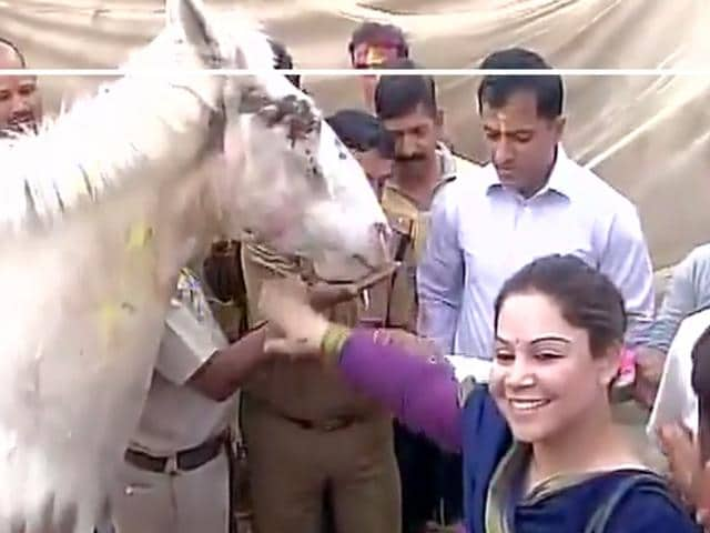 The police official were seen smearing colour on the horse and clicking selfies.