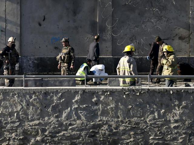 Afghan security forces keep watch at the site of an explosion in Kabul.