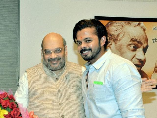BJP President Amit Shah with Cricketer S Sreesanth during a meeting at Party's office in New Delhi on Friday, March 25, 2016.