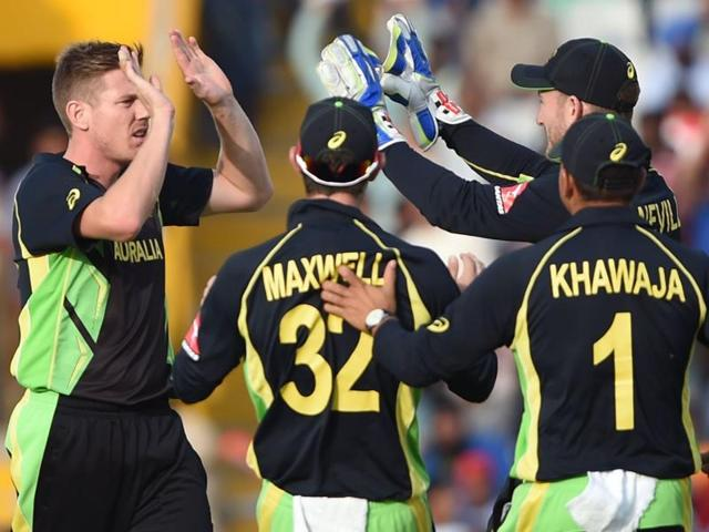 Australia's James Faulkner celebrates with teammates after bowling out Pakistan's Sharjeel Khan.