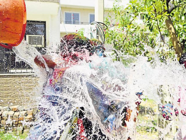 Taps were left open as residents played with water to celebrate Holi on Thursday.