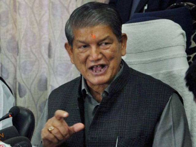 Uttarakhand chief minister Harish Rawat (R) has been facing a major crisis with nine Congress legislators protesting against the party.