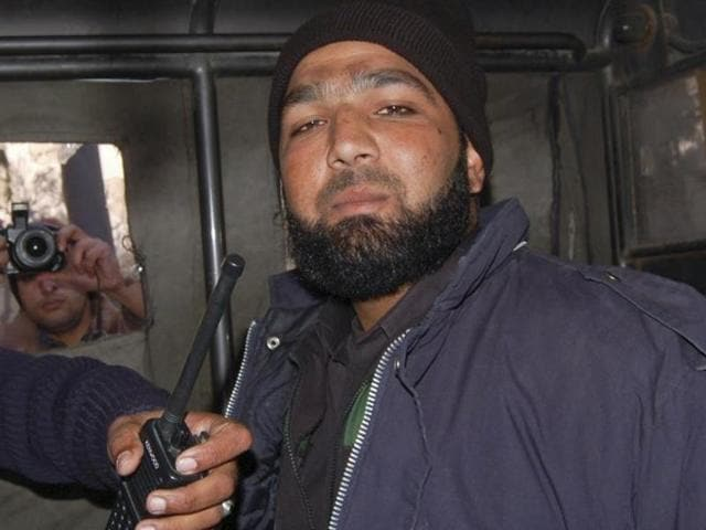 Malik Mumtaz Hussain Qadri, a bodyguard who killed Punjab governor Salman Taseer, is photographed after being detained at the site of Taseer's shooting in Islamabad, in this January 4, 2011 file picture.