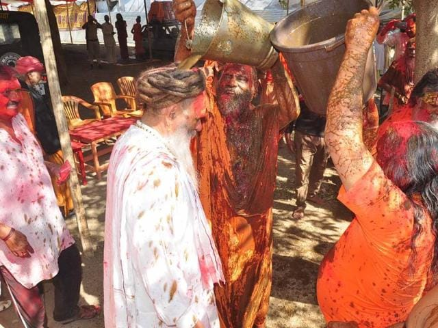 Sadhus play Holi in Ujjain with cow dung and cow urine on Wednesday.