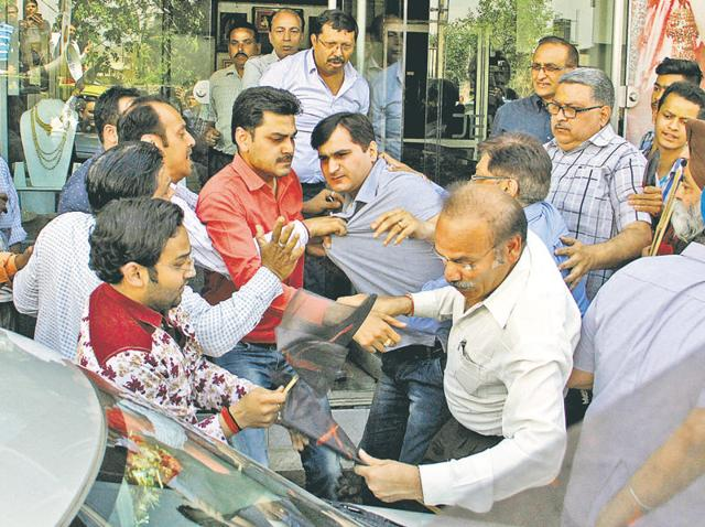 Jewellers enter into a brawl over opening of shops on Hambran Road in Ludhiana on Wednesday.