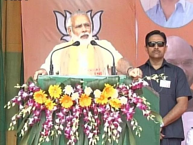 Prime Minister Narendra Modi addresses a rally in Tinsukia