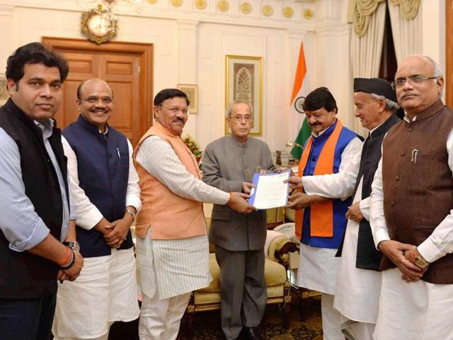 President Pranab Mukherjee meeting with a BJP delegation at Rashtrapati Bhavan in New Delhi on Saturday, March 26, 2016.