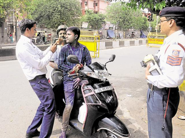Traffic police conduct a breathalyser test on a motorist on Thursday. More than 1,900 people were booked by the cops for drunken driving on Holi.