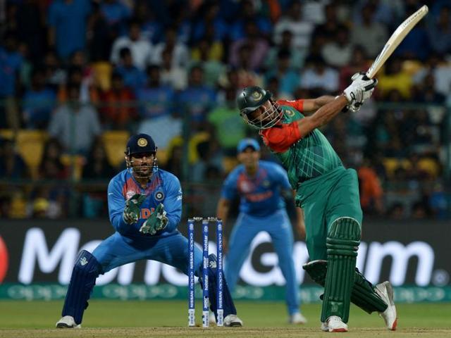 Bangladesh bowler Al Amin with team mates celebrate the wicket of India's Hardik Pandya.