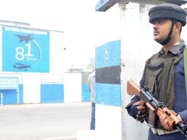 A soldier stands guard outside the Pathankot air base..