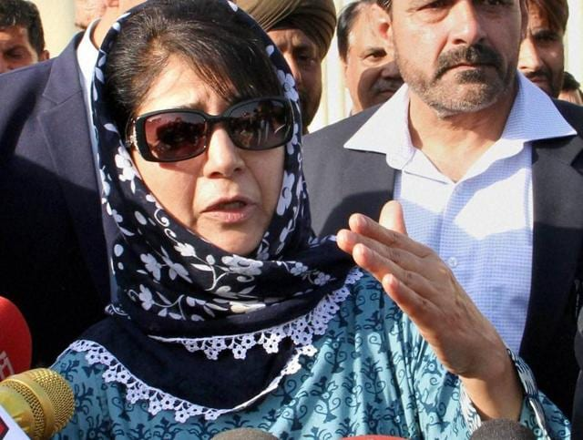 PDP chief Mehbooba Mufti interacts with journalists in Jammu after meeting governor NN Vohra at Raj Bhawan.