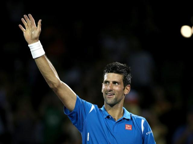 Novak Djokovic of Serbia is congratulated by Kyle Edmund of Great Britain during the Miami Open on March 25, 2016 in Key Biscayne, Florida.