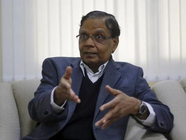 Arvind Panagariya, head of the government's main economic advisory body, gestures during an interview in New Delhi.