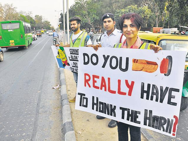 Members of an NGO and traffic cops launching a no-honking drive opposite the PGI in Chandigarh on Saturday.