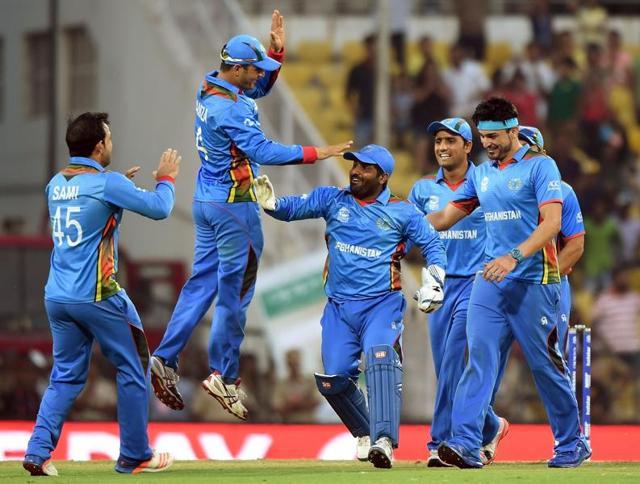Afghanistan's Mohammad Nabi celebrates with teammates the dismissal of West Indies' Dwayne Bravo.