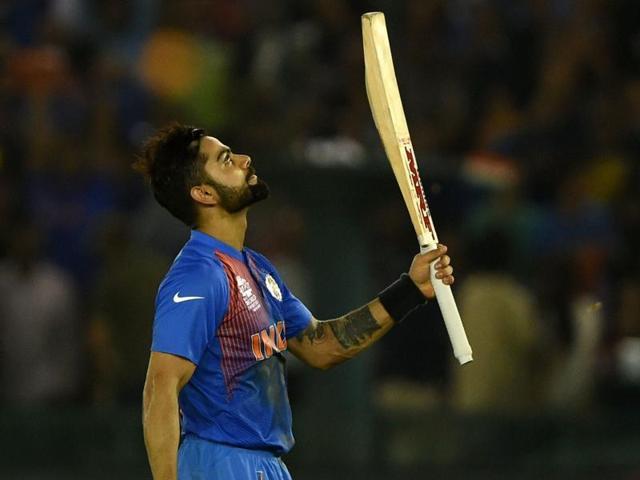 Virat Kohli (L) celebrates as Australia's James Faulkner watches after India's win.