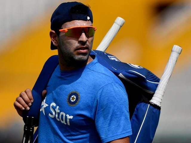 India's Yuvraj Singh walks with his equipment during a training session at The Punjab Cricket Stadium.